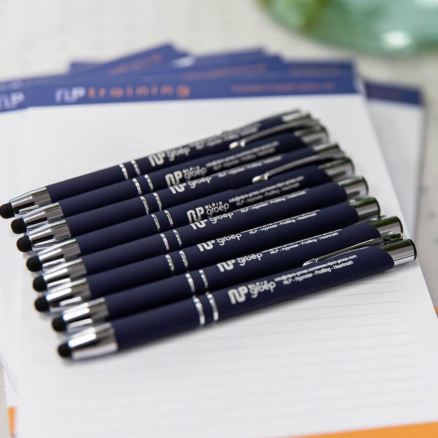 Pennen en kladblokken voor NLPro Training